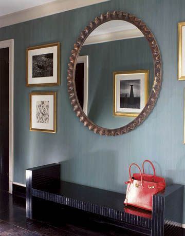 Albert Hadley: A scalloped wood-and-gesso mirror above a lacquered bench in the foyer shows the reflection of a photograph taken in Peru by the American photographer Louise Dahl-Wolfe, famous for her Harper's Bazaar fashion work.