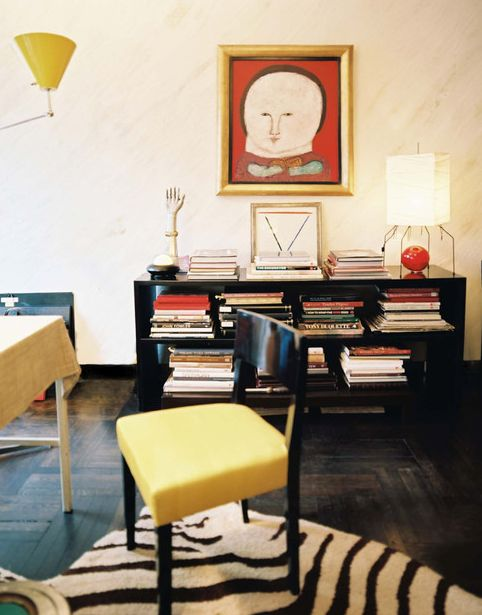 Albert Hadley's bookcase, zebra rug and yellow chair.