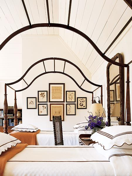 Amelia Handegan Traditional guest bedroom in black and white with ornate wrought iron bed