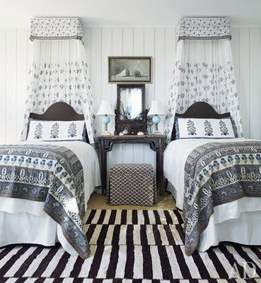 Amelia T. Handegan, a South Carolina interior decorator, used an eclectic assortment of Indian textiles and a graphic Persian kilim in this guest room at her bohemian bungalow in Folly Beach, near Charleston. (July 2011)