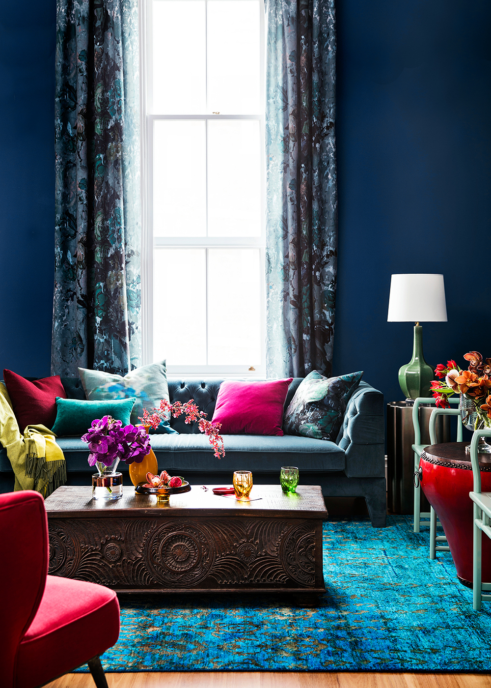 Contemporary living room walls painted in Dulux Passionate Blue. Via Home Beautiful