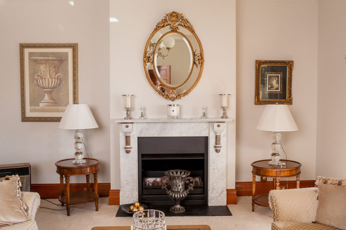 Fireplace in the living room of a neutral color schemed living room in Australia