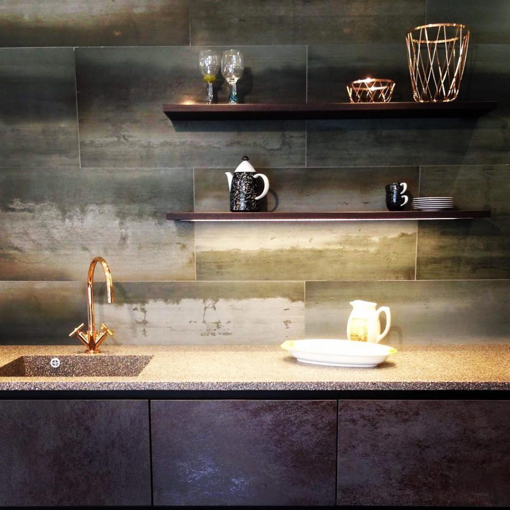 Kitchen wall with concrete tiles