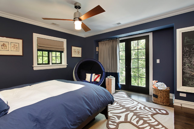Contemporary boys bedroom with a navy blue color scheme with walls painted in Benjamin Moore Van Deusen Blue