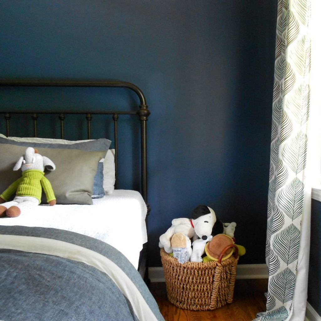 Navy blue bedroom color scheme with walls in Benjamin Moore's Van Deusen Blue