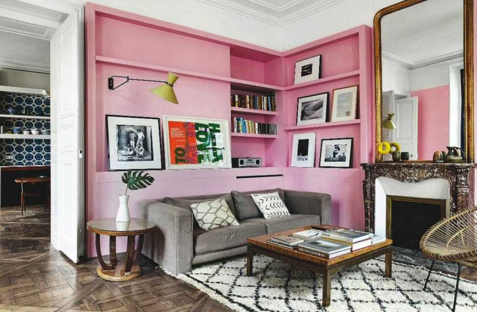 Barbie Pink Wall Paint Color. Living room with pink walls and bookshelves, pink paint color scheme