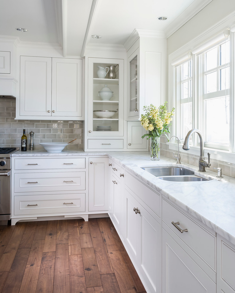 Benjamin Moore Simply White Painted Kitchen Cabinets. White kitchen color scheme with timber floors.