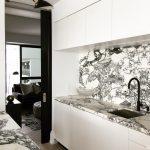 Black and White Marble Kitchen Color Scheme. Timber herringbone flooring kitchen, black taps and hardware.