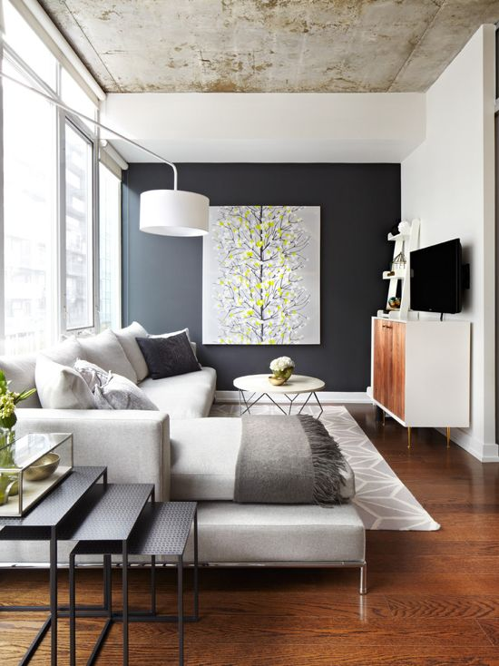 Dark gray feature wall in the modern living room, concrete ceiling, gray paint color scheme
