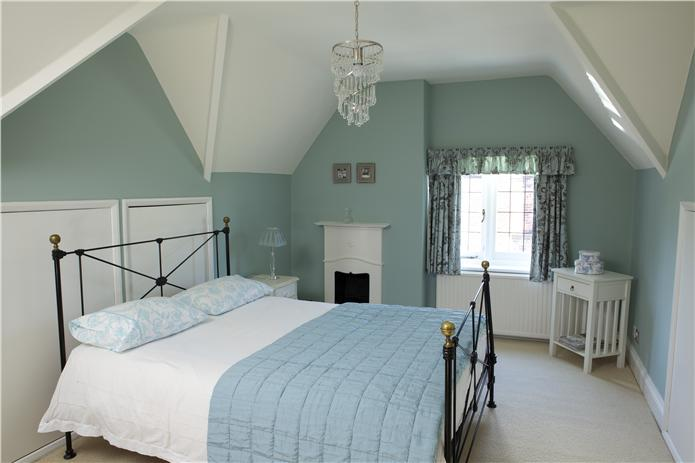 Farrow & Ball Blue Green Painted Bedroom Walls. Muted teal paint color scheme.