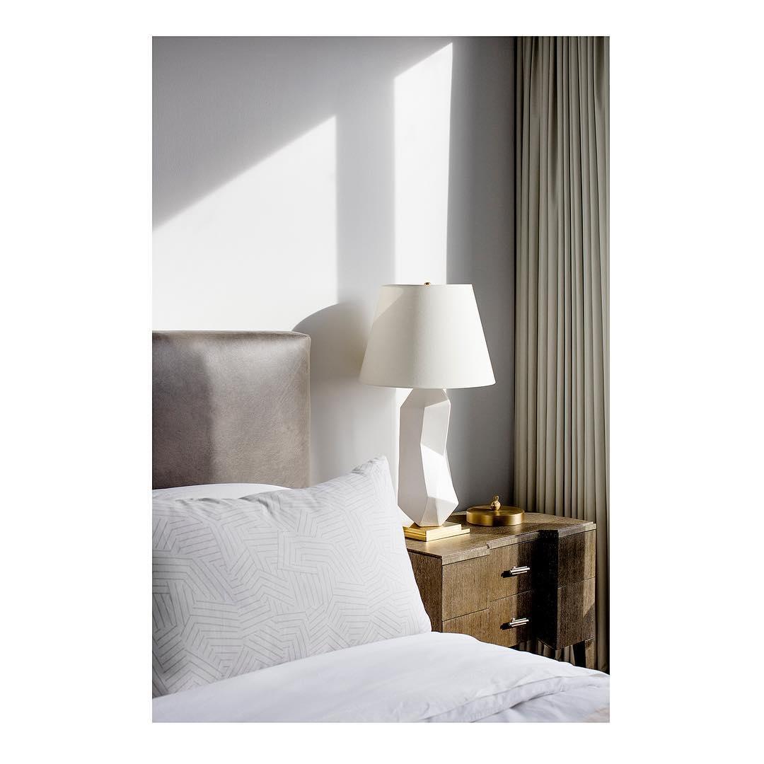 Light gray velvet armchair and walls