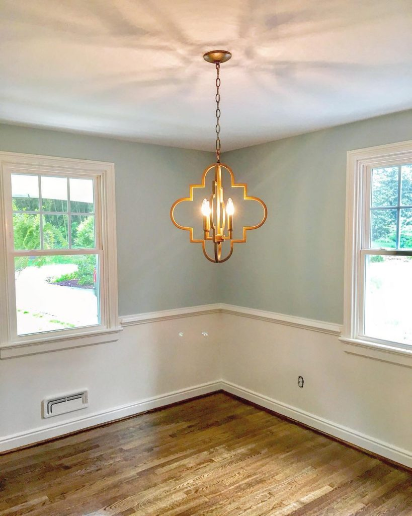 Sherwin Williams Sea Salt with white wainscoting living room paint color scheme