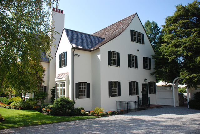 Tudor Home Exterior Painted in Benjamin Moore Simply White