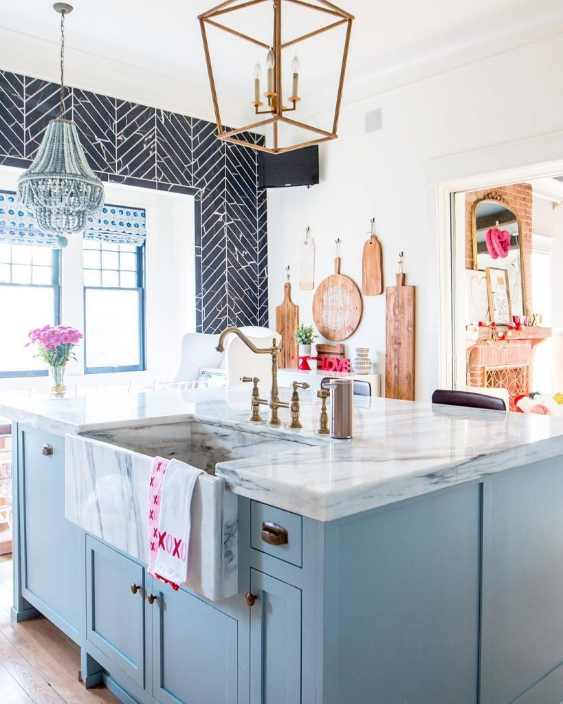 modern vintage kitchen in powder blue, white and black with pink accents