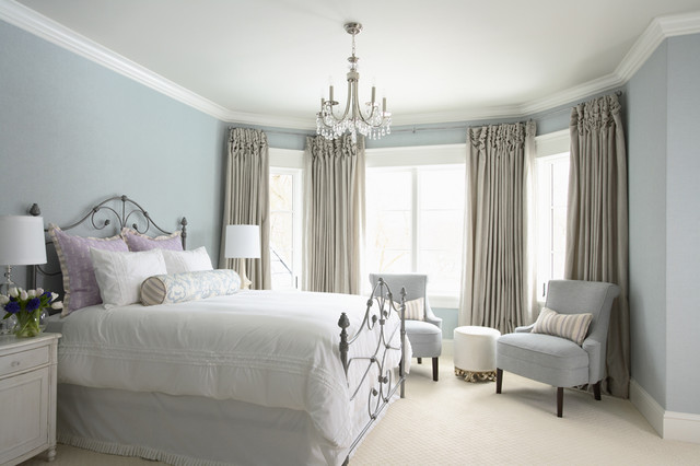 Light blue bedroom color scheme with Benjamin Moore's Summer Shower on the walls and Glacier White on the ceilings.