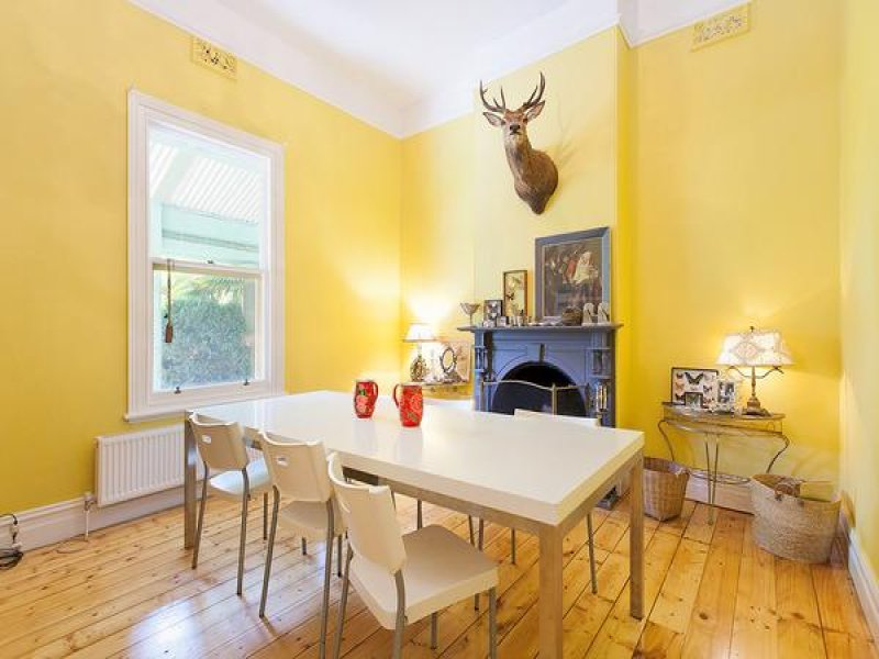 Yellow painted dining room color scheme