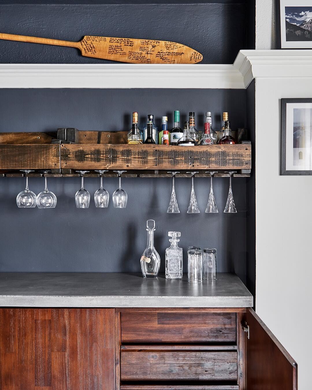 Custom wine rack and wall painted in Benjamin Moore Hale Navy