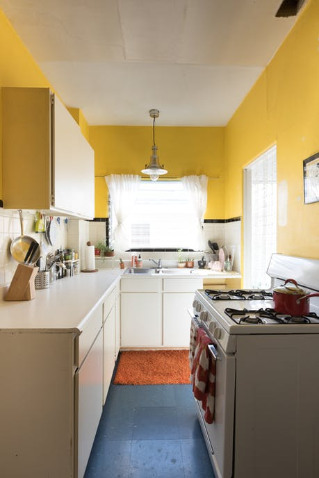 Modest kitchen with yellow painted walls