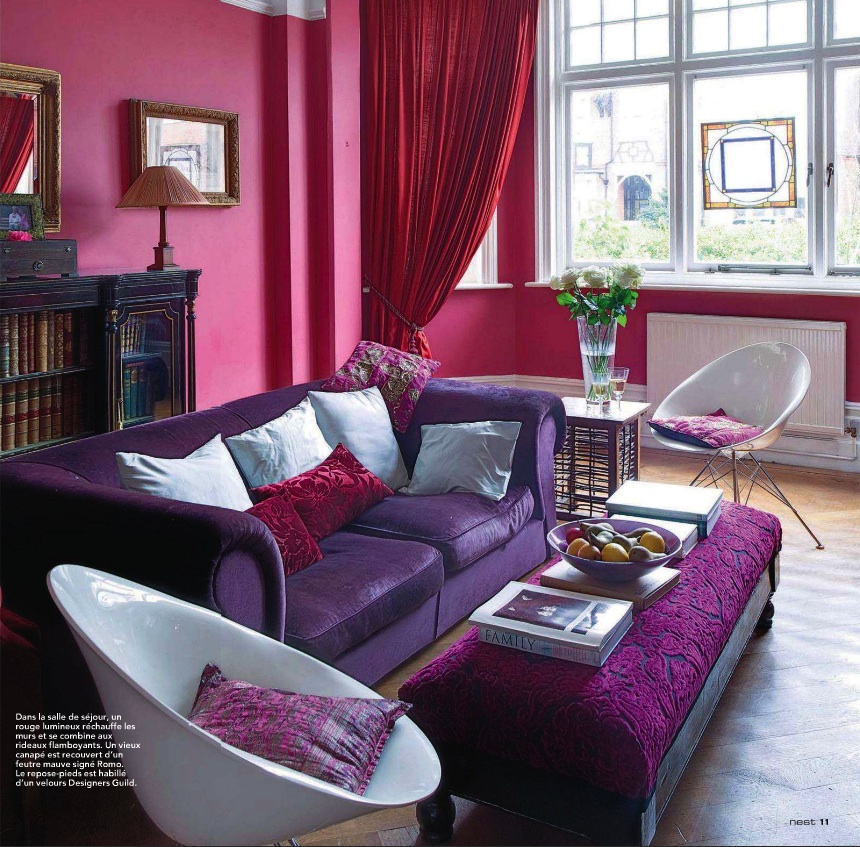 Deep pink and purple living room idea. Pink and purple living room color scheme in bold saturated colors.