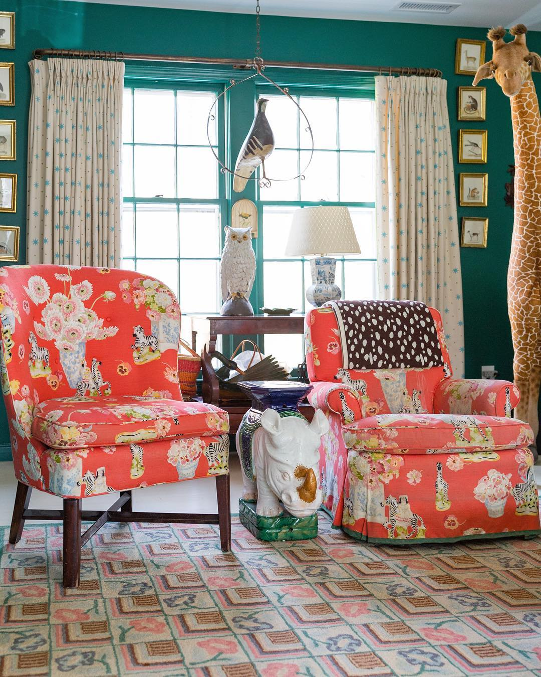 Living room in a green and coral color scheme with an animal motif interior design.