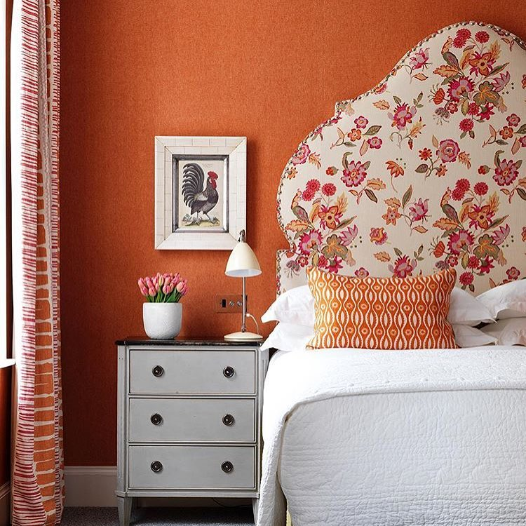 Orange color scheme bedroom design Traditional.