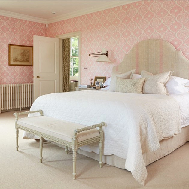 Pink and white color scheme bedroom.