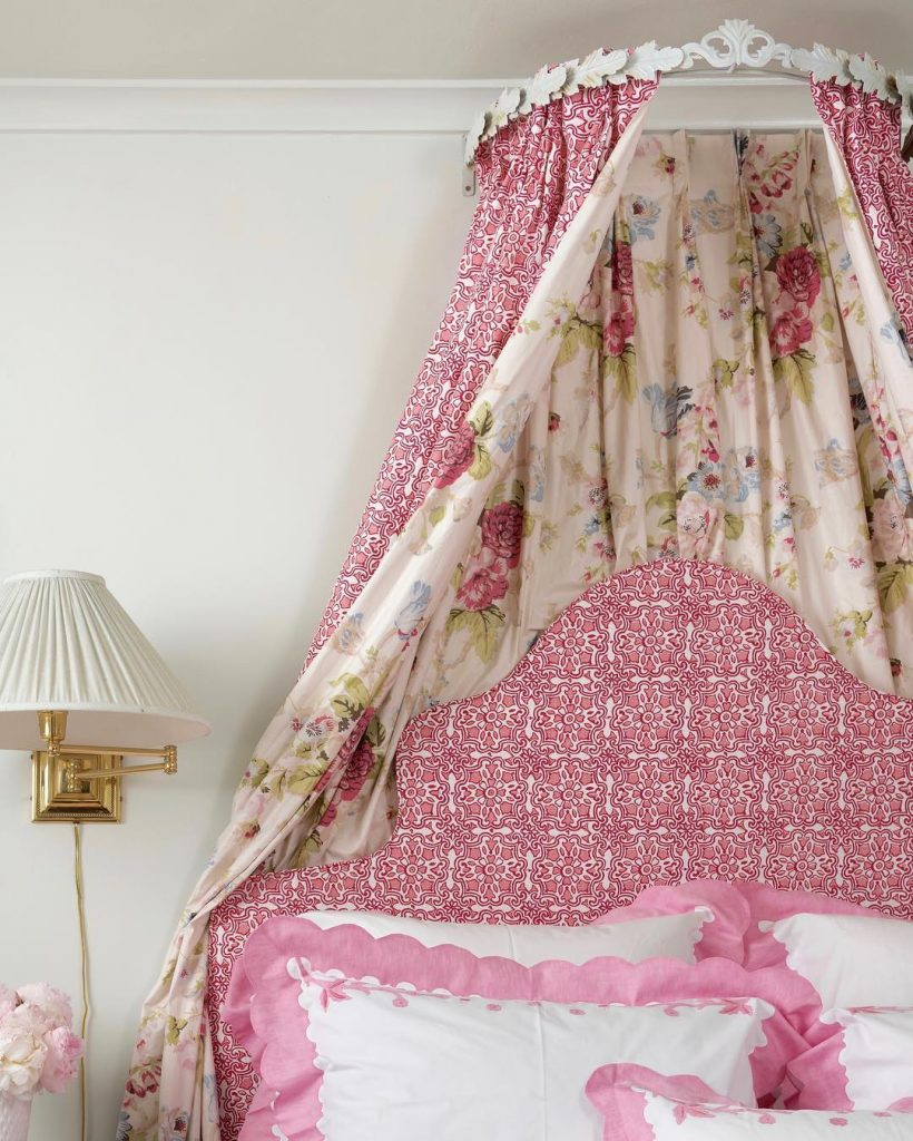 Pink canopy bed with florals by Blithfield Fabrics.