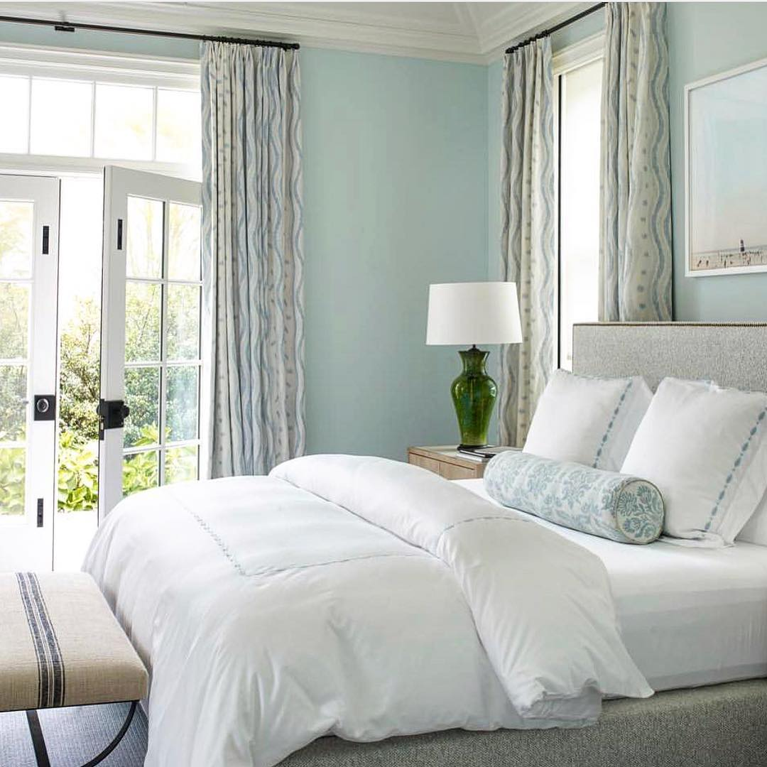 Traditional bedroom with a light blue color scheme and Ikat Stripe curtains by Blithfield.