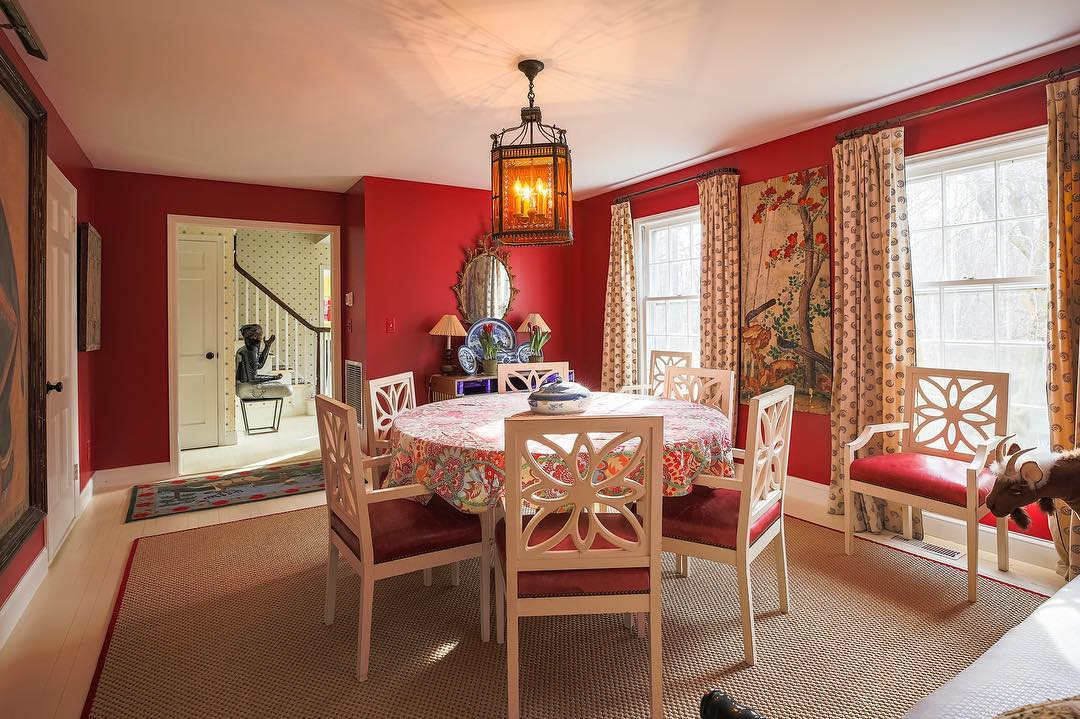 Traditional red dining room color scheme.