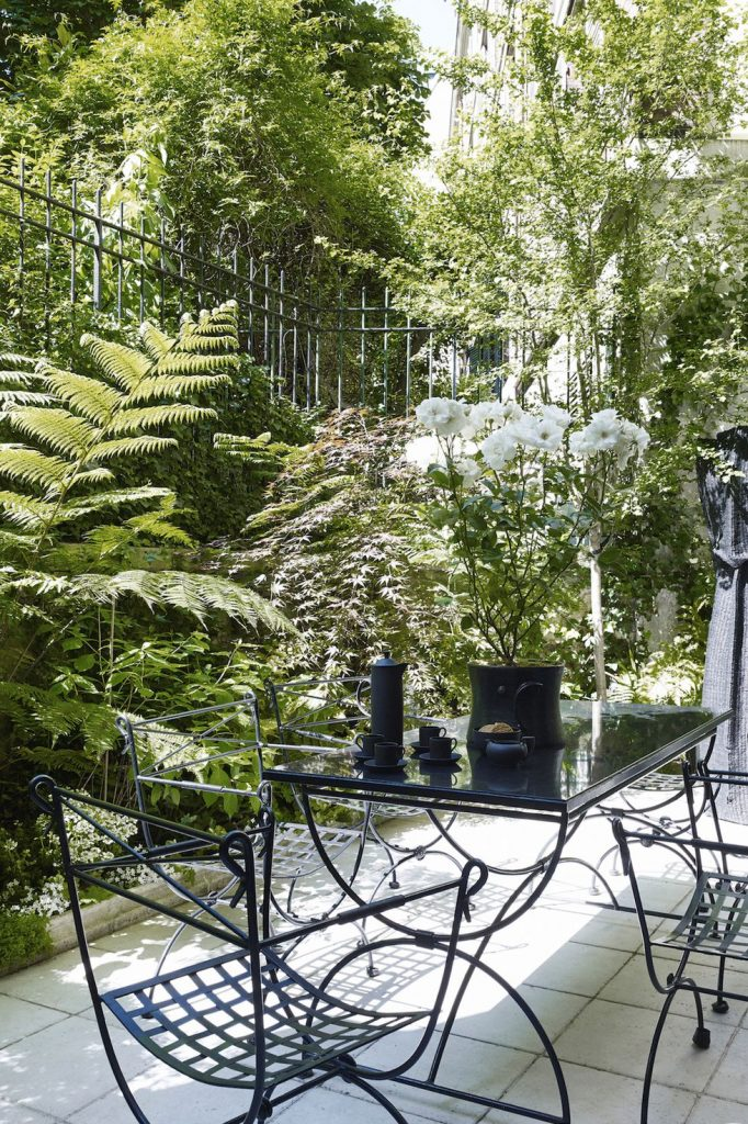 classic green patio idea with steel garden furniture
