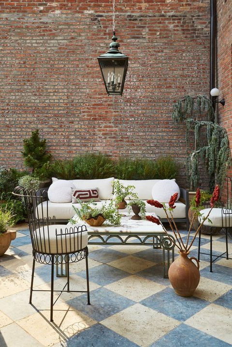 Patio with blue and white checkered floor and brick walls