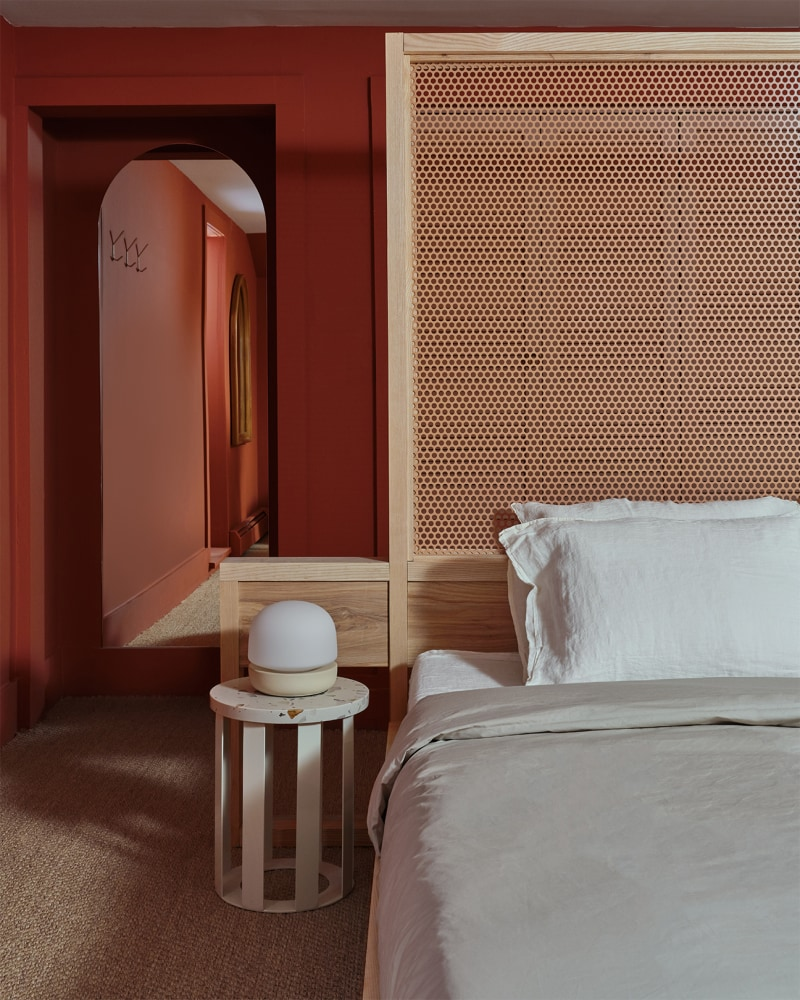 Bedroom with rusty red painted walls