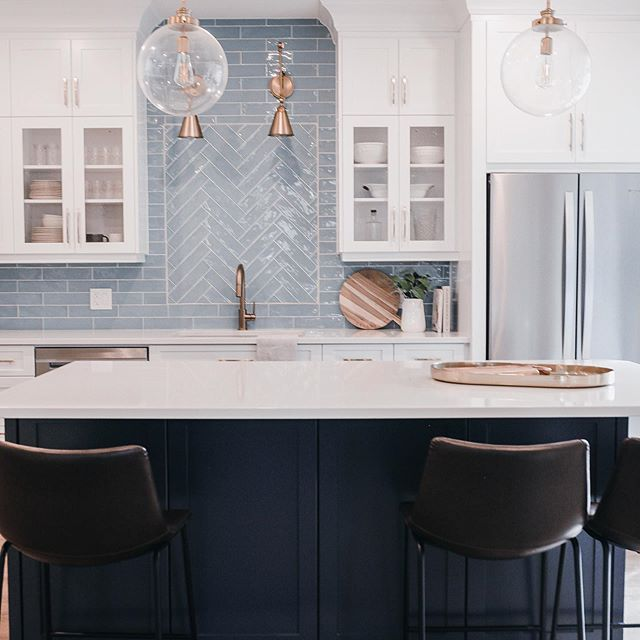Blue kitchen islande painted in Benjamin Moore Van Deusen Blue