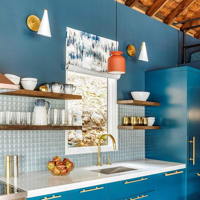 Blue kitchen with brass hardware