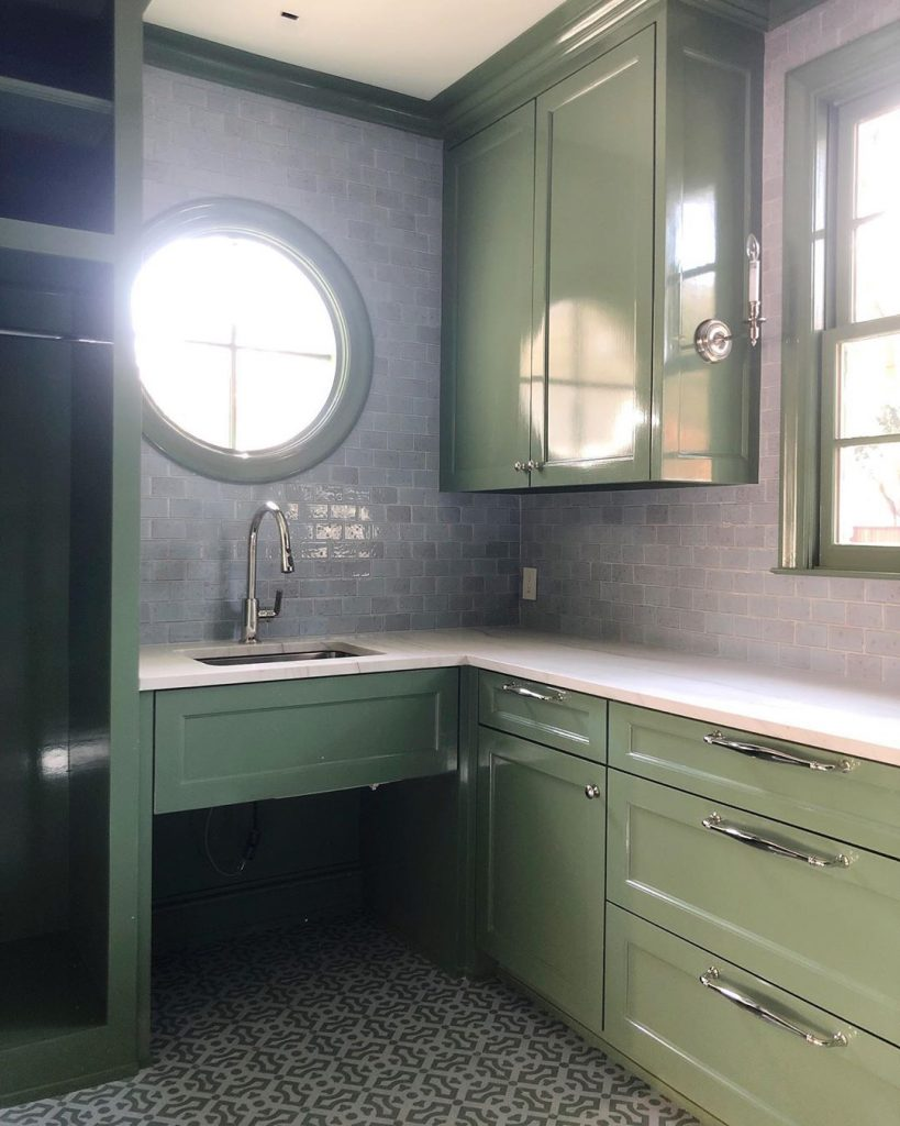 Cabinets painted in Farrow and Ball Calke Green
