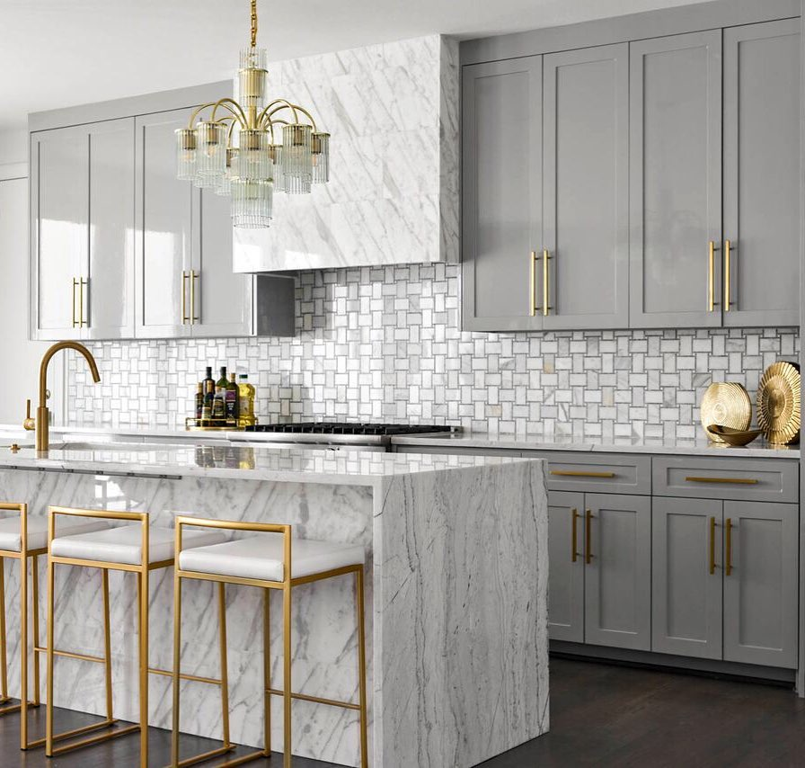 Callacatta gold marble waterfall kitchen counter and gray painted kitchen cabinets