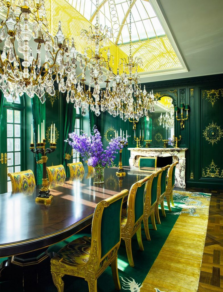 Formal dining room in green and gold color scheme