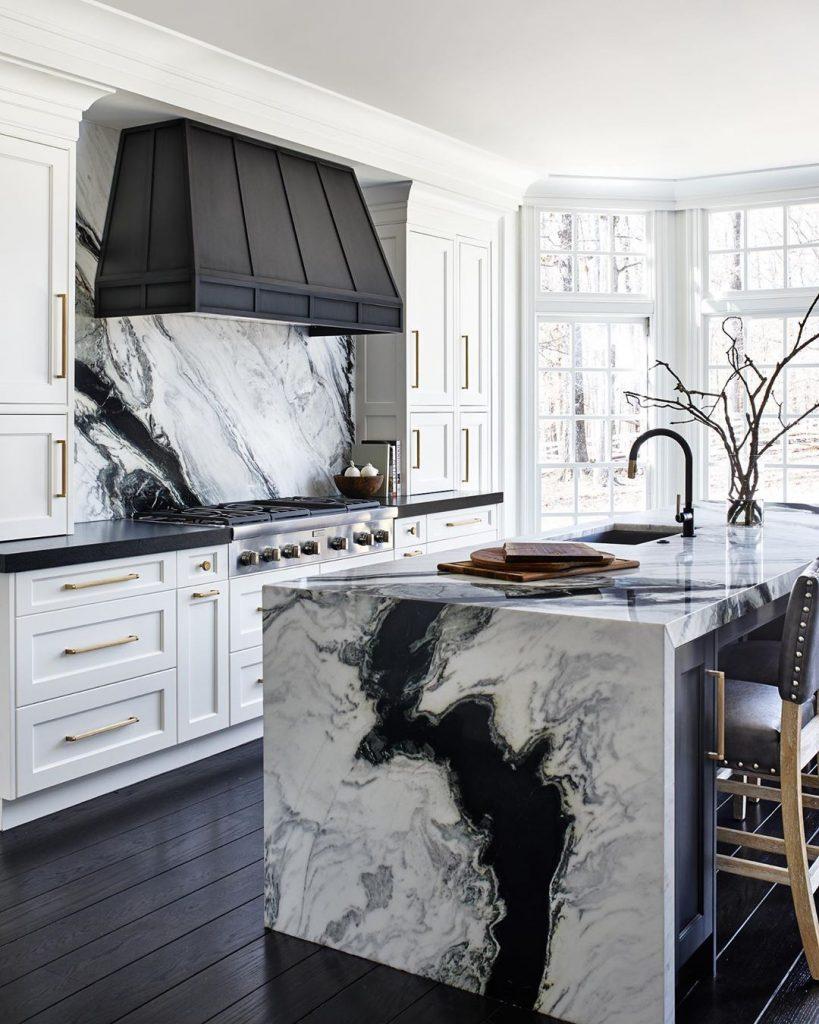 Kitchen with black and white vein marble splashback and island