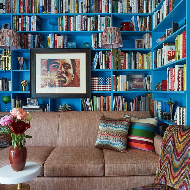Turquoise blue painted book shelves home library