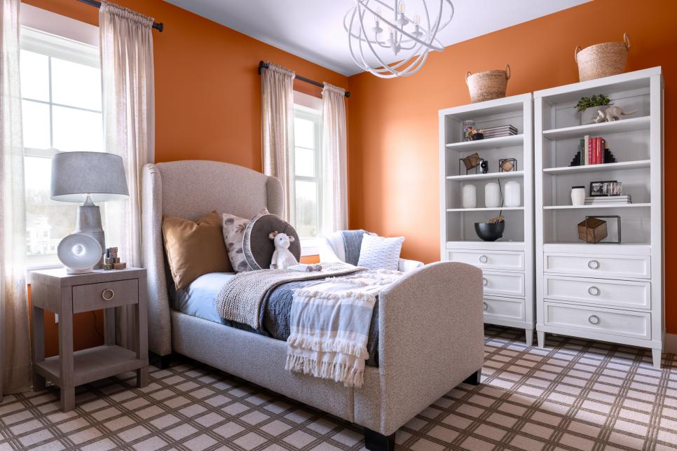 Child bedroom with orange painted walls