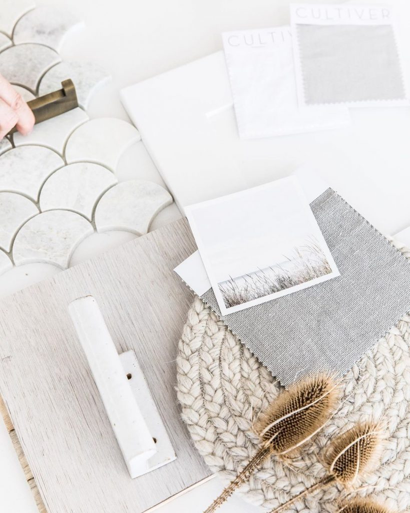 Flat lay in white and neutrals fishscale tiles