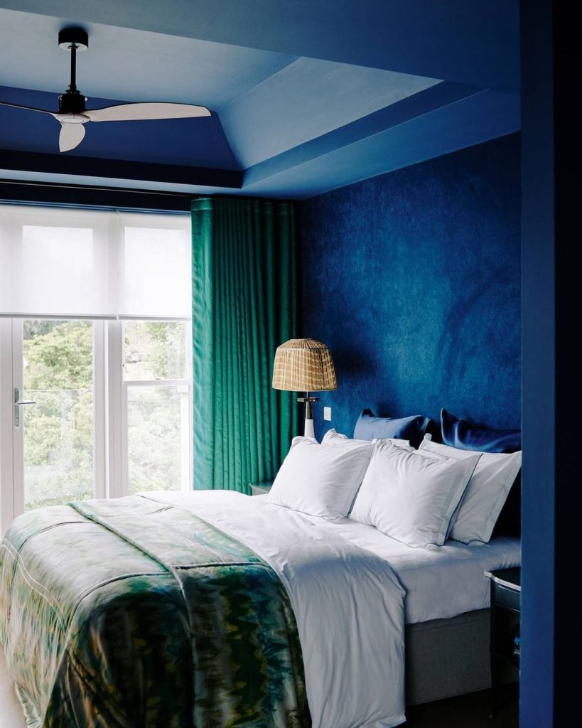 Luxurious blue and green master bedroom interior 2020