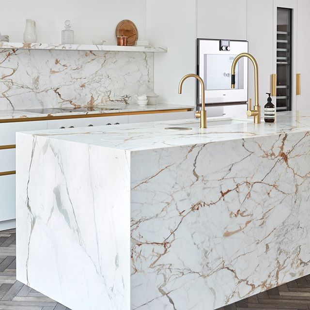 Marble kitchen design with brass fittings design 2020