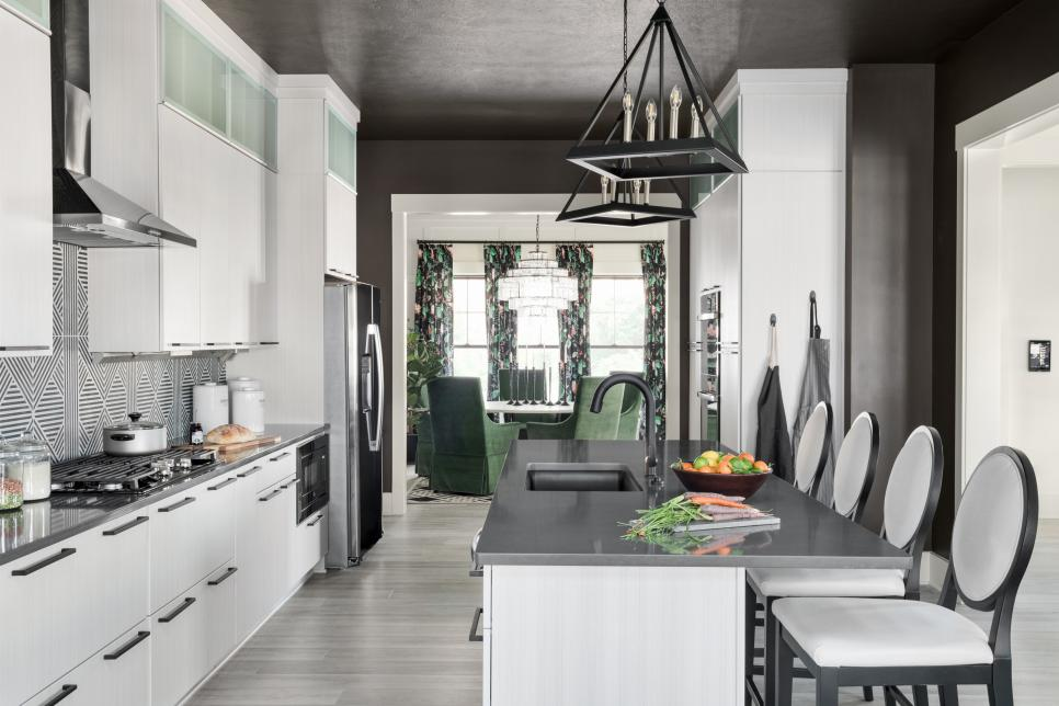 A large island covered in a charcoal-hued quartz countertop is the central hub of the kitchen. It provides plenty of prep space, dining for four and it's also a nice spot to visit with the cook while they're preparing a meal.
