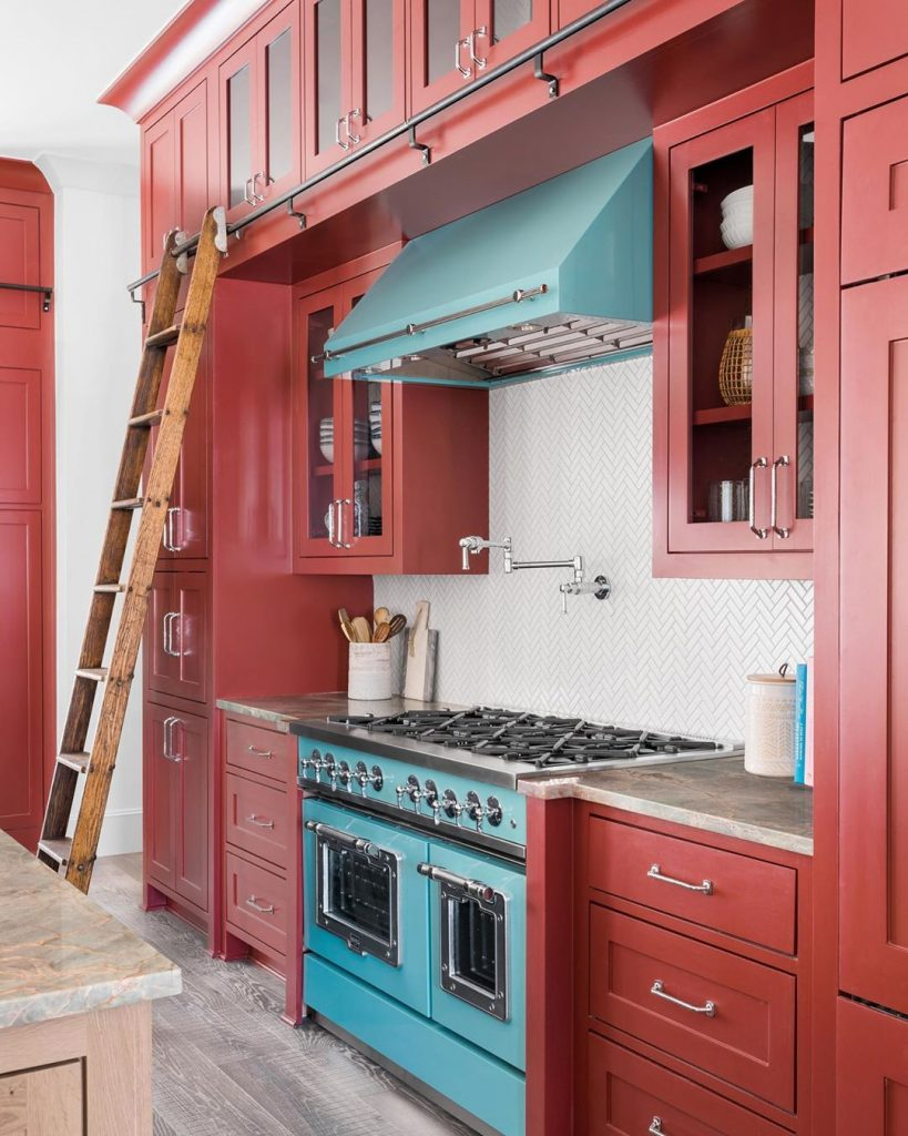 Red kitchen cabinets painted in Benjamin Moore Dinner Party  blue rangehood