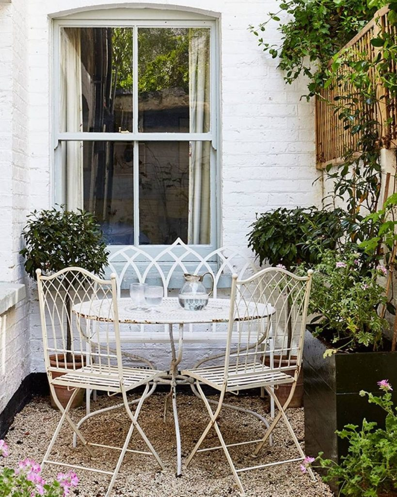 Small patio decor with cast iron chairs and table