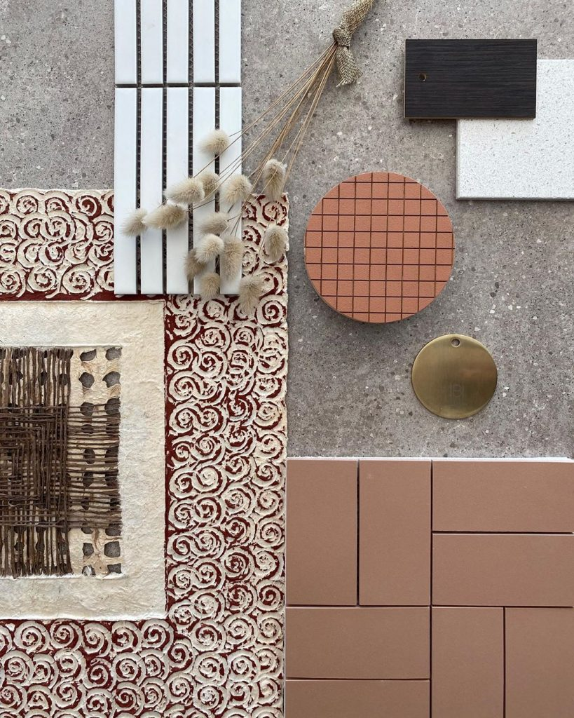 brushed brass and terracotta interior design flat lay styling
