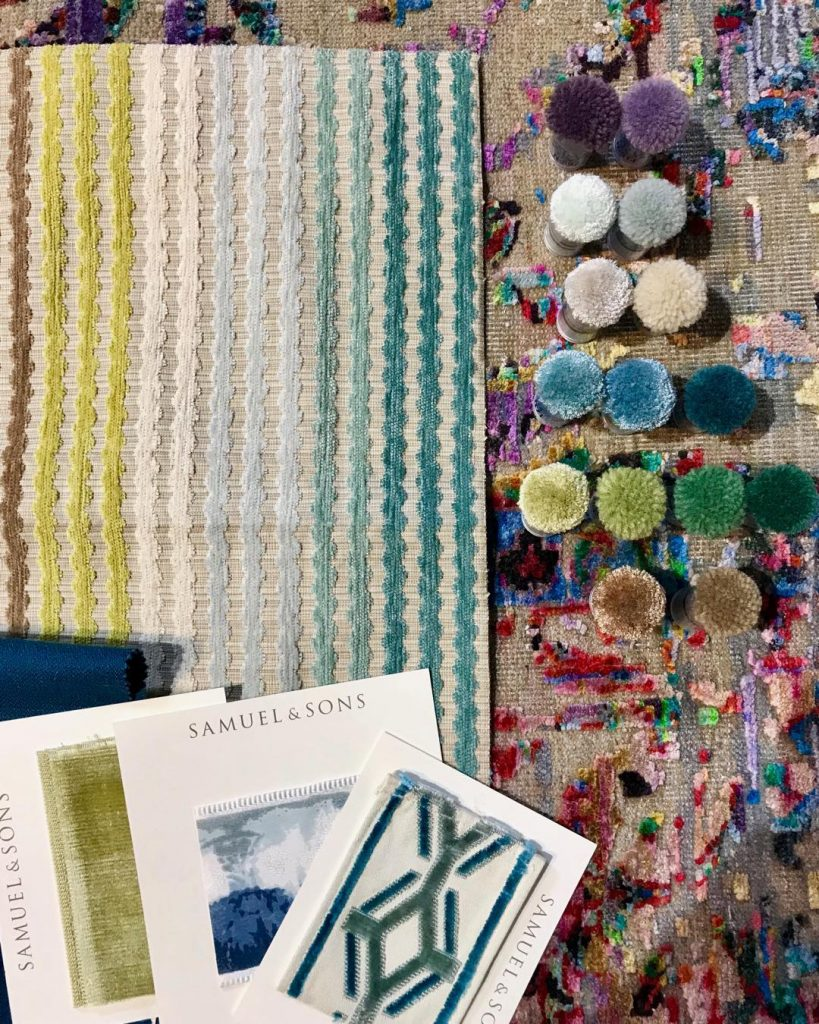 Custom rugs are really not that scary. And sometimes they're the perfect fit! Our client has a penchant for color, so we picked the pattern and the appropriate size, then selected poms to match our fabrics.