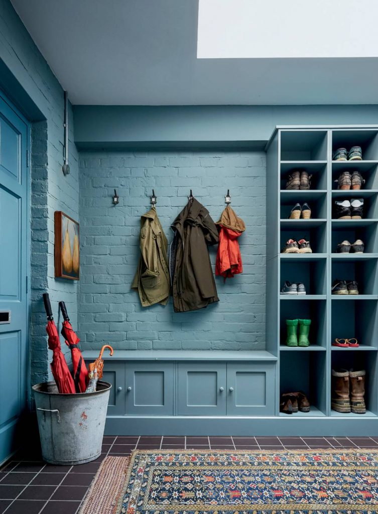 Joinery in the boot room was painted in Farrow & Ball's 'Claydon Blue' to tone with walls in 'Oval Room Blue'