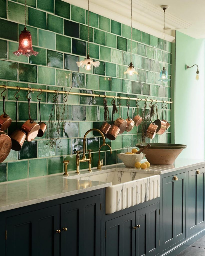 Green kitchen with a marble sink